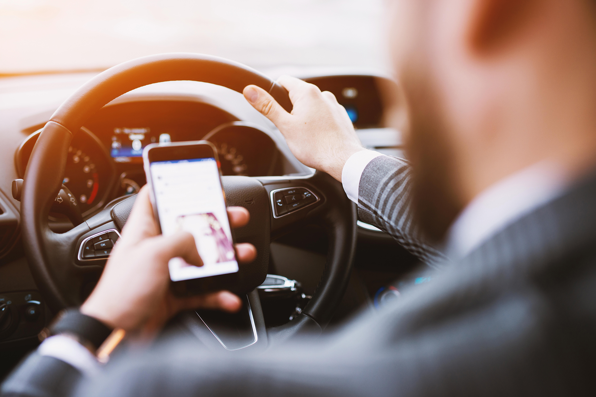 Driver Looking at Phone While Driving